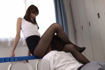Japanese teacher blows a stiff cock while in the lockers